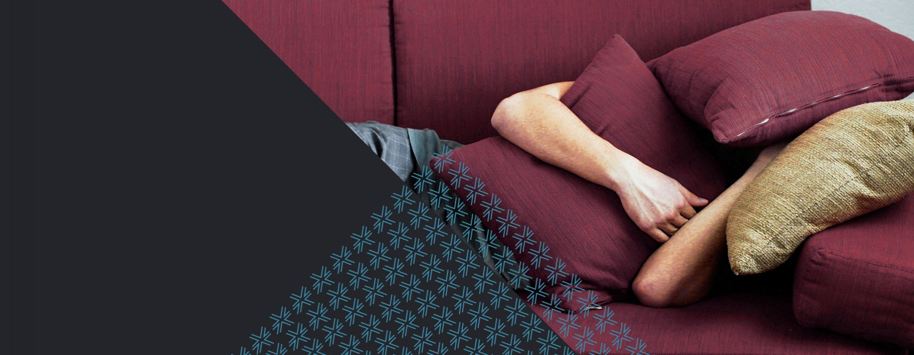 Person laying on the couch with a pillow covering face